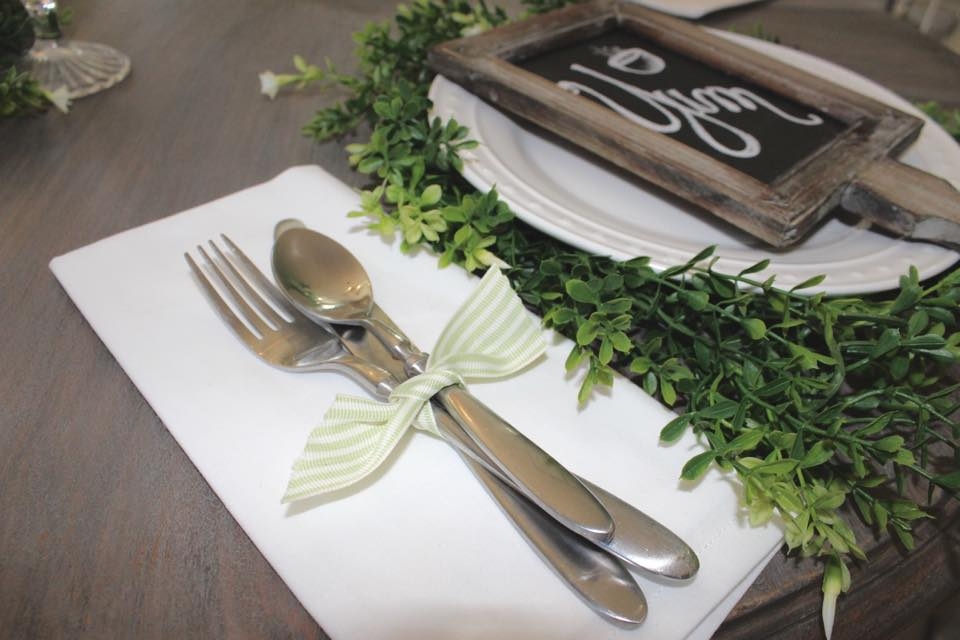 spring table setting silverware tied with ribbon