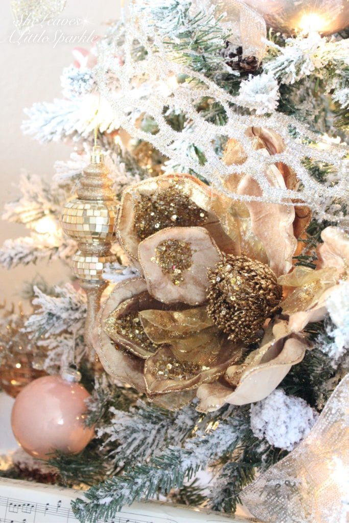 Holiday Living Room Tour blush gold flocked christmas tree blush wrapping paper pink christmas gold bronze beaded flowers