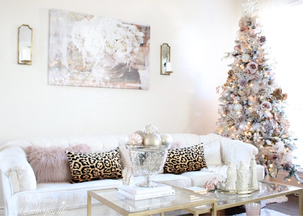 Holiday Living Room Tour blush gold flocked christmas tree blush wrapping paper pink christmas leopard pillows stuck on hue