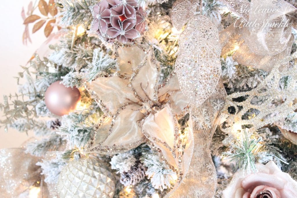 Holiday Living Room Tour blush gold flocked christmas tree blush wrapping paper pink christmas champagne poinsettia stems blush ornaments