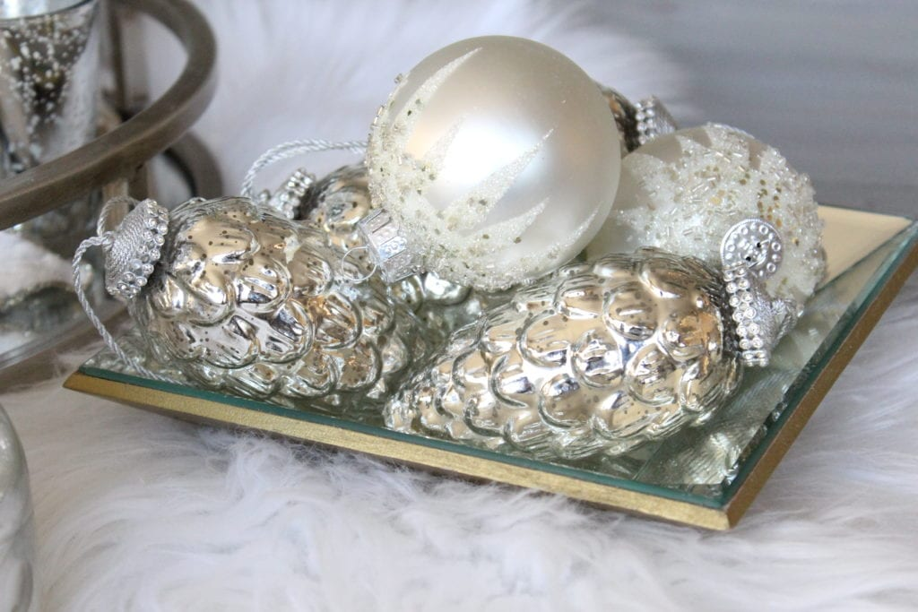 Styling a Christmas coffee table mercury glass pinecone rhinestone ornaments