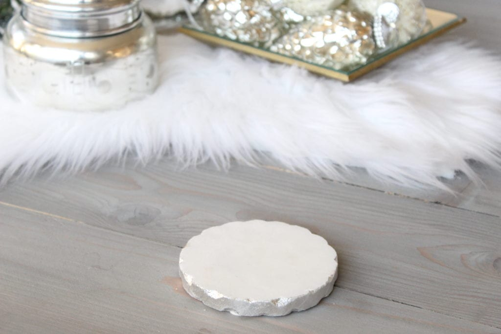 Styling a Christmas coffee table white silver marble round coasters