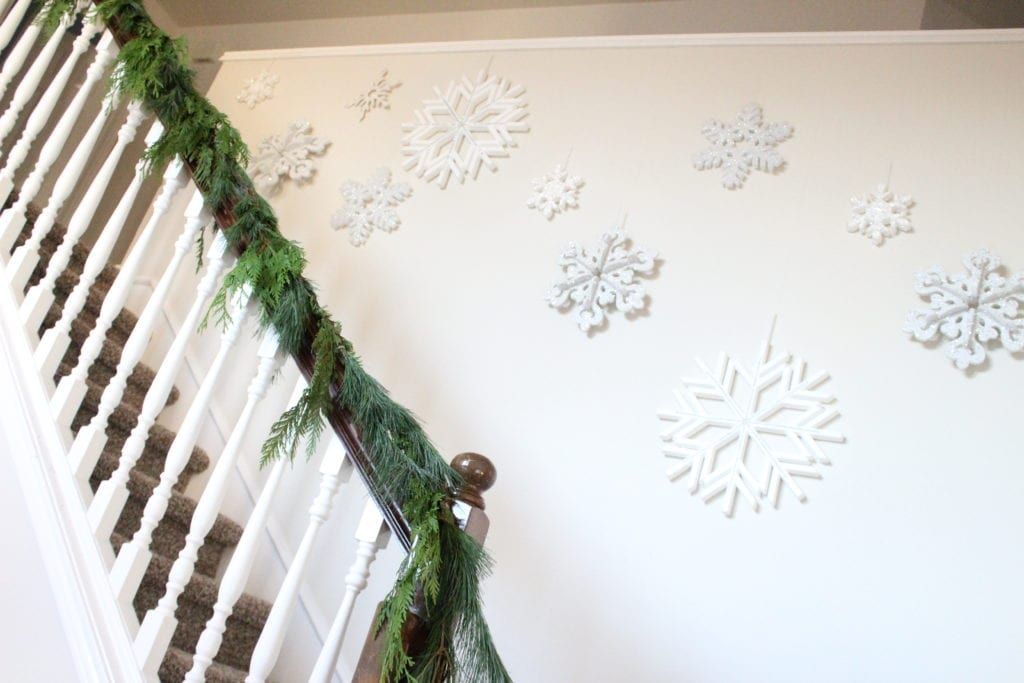 how to hang garland on your banister fresh green evergreen cypress pine garland home depot nursery fresh diy christmas holiday garland snowflakes hanging down stairs stairwell wall