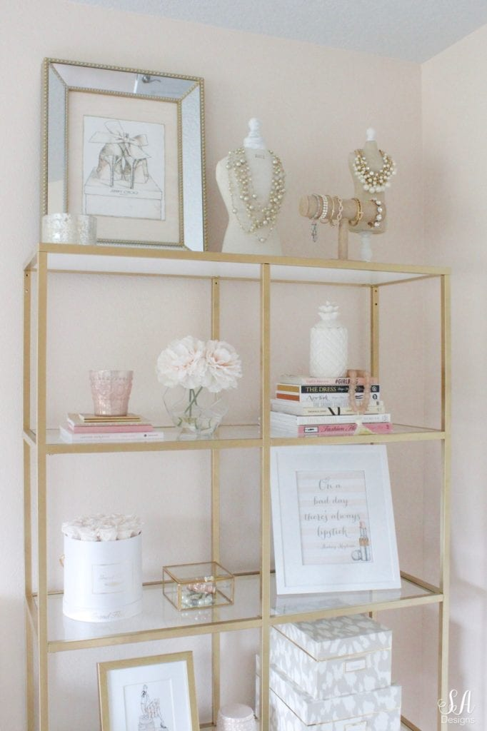 ikea hack vittsjo shelves,fashion books, fashion coffee table books, style books, blush pink sea glass beads, pineapple ceramic candle, ikea hack shelves, glam style office, decorating with books