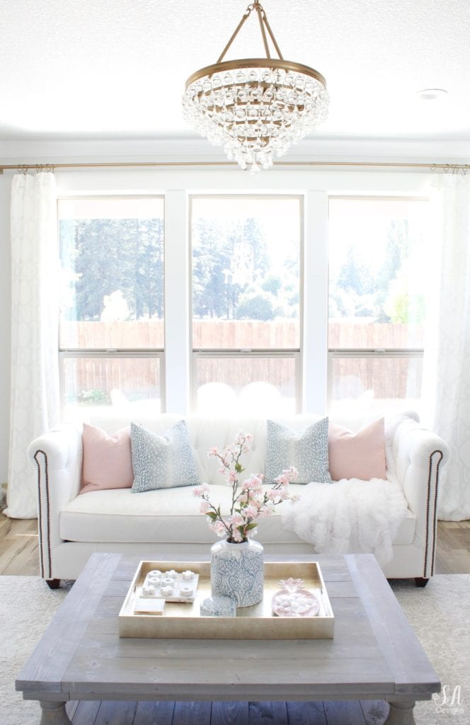 crystorama calypso chandelier, white interiors, white sofa, chesterfield sofa, bright white homes