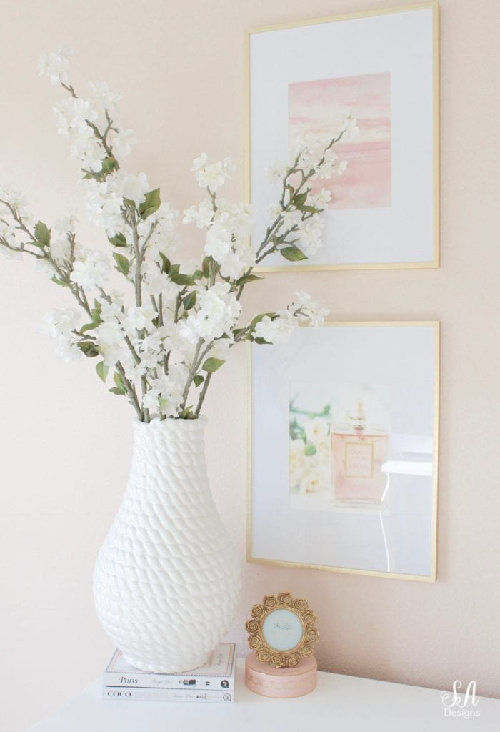 blush pink interior paint walls, glam style office, decorating with books styling with books, megan hess books