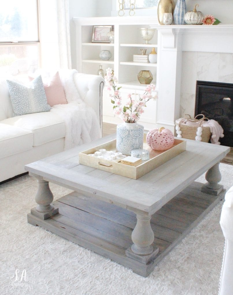 blue and pink, blush and blue decor, white sofas, white interiors, fall living room, glam fall style, fall coffee table, restoration hardware baluster coffee table, pink pumpkin, blue ceramic ginger jar, gold tray, blue spa fawn print pillows, blush pink throw pillows, marble white fireplace