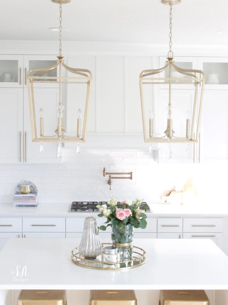 loveliest looks of fall tour 2018, white kitchen design, shaker kitchen cabinets, kitchen island brass pendant lighting, white and gold, fall decor fall decorations, glam fall decor, elegant classy fall decor decorations, mercury glass pumpkins, fresh roses, brass mirrored tray, fall kitchen, styling a kitchen island