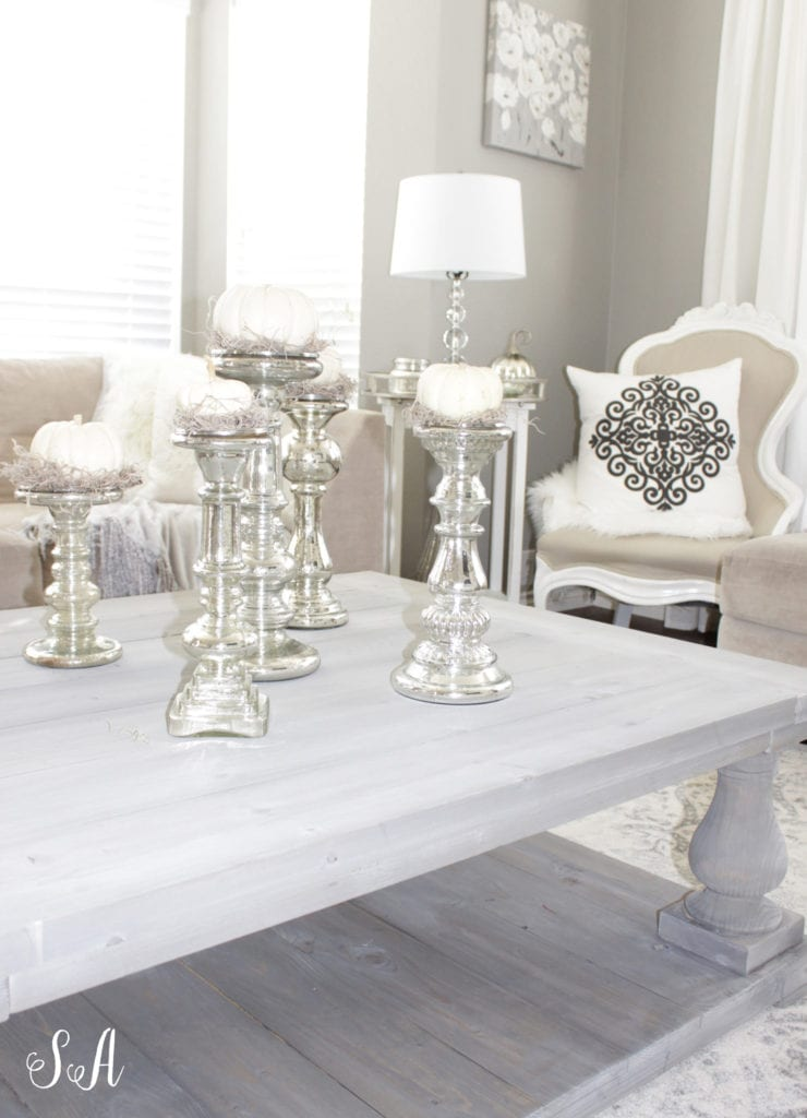white pumpkins on mercury glass candleholders, fall coffee table, neutral fall decor