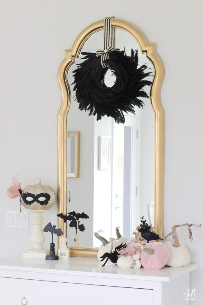 black eye mask, halloween mask, costume mask, blush pink feather joanns, swarovski crystals, diy halloween mask, diy halloween craft, diy mask, glam halloween decor costume, chic halloween decor, elegant halloween decor, blush pink and black masquerade mask