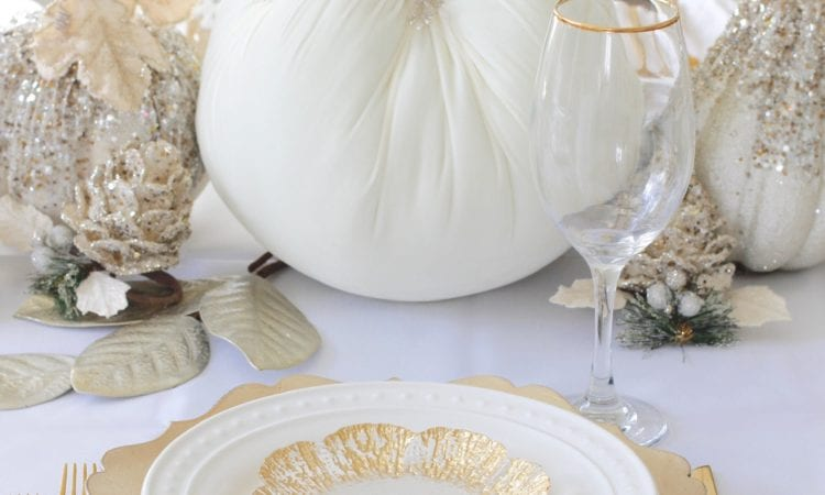 Thanksgiving table, fall table, fall tablescape, white and gold table setting place setting, elegant thanksgiving decor, chic glam thanksgiving decor, zgallerie beaded pumpkins and gourds and leaves, hotskwash velvet pumpkins, white gold champagne ivory tablescape, crystal chandelier, white kitchen design, brass pendant lights, brass hardware, vintage dining set, french inspired style, live in perigold, zgallerie beaded leaves and grape clusters