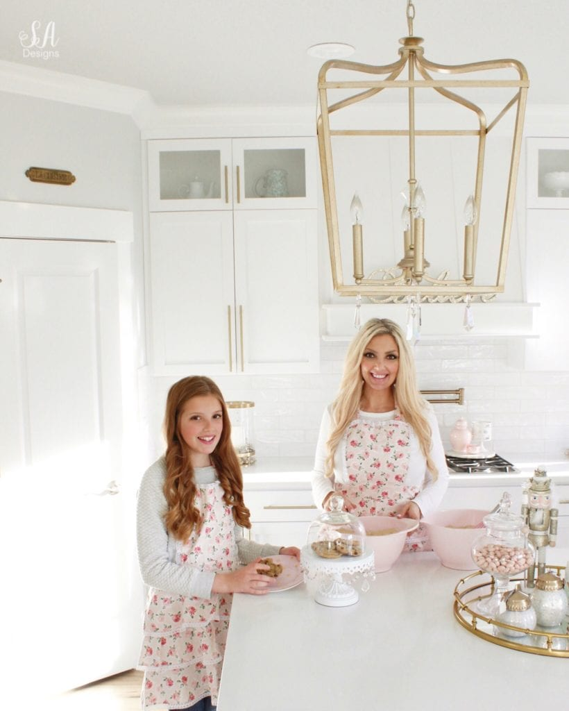 mommy and me apron, mother daughter apron, sugar baby aprons, pink kitchenaid mixing bowls, summer and brooklyn adams, white kitchen, brass pendant lights