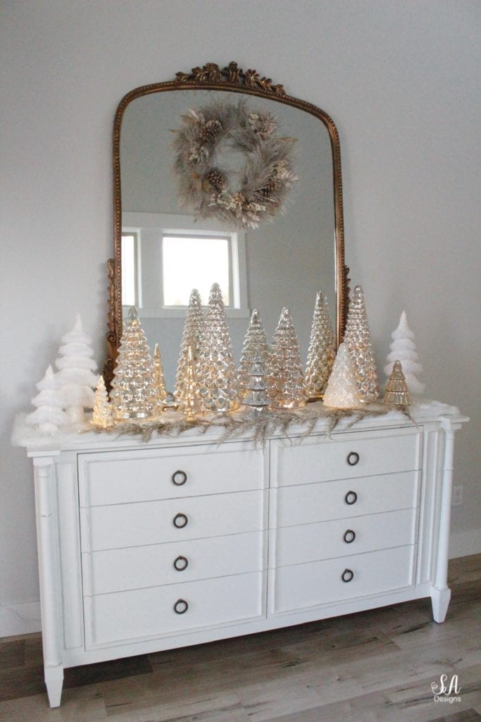 pottery barn mercury glass trees, anthropologie gleaming primrose glass mirror, elegant mixed metal decor, gold wreath, perigold dresser entry buffet table white transitional style buffet