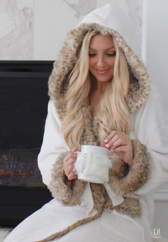 pottery barn faux fur robe dune leopard, pottery barn faux fur slippers, leopard print robe, pottery barn pottery barn teen faux fur ivory throw blanket, white interiors, interior blogger, blonde hair, blogger hair, tea in front of fire, cuddling by the fire, white marble tile fireplace mantel hearth, pottery barn candles tuberose