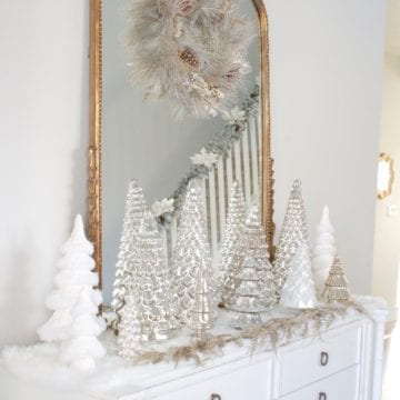pottery barn mercury glass trees, anthropologie gleaming primrose glass mirror, elegant mixed metal decor