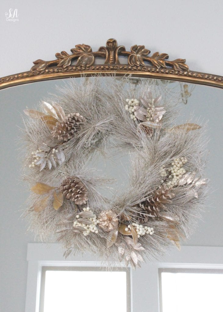 pottery barn mercury glass trees, anthropologie gleaming primrose glass mirror, elegant mixed metal decor, gold wreath, perigold dresser entry buffet table white transitional style buffet, michaels white faux fur christmas trees, gold leaves wreath
