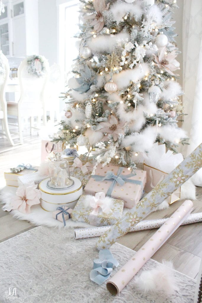 nutcracker christmas decor, swan lake theme decor, nutcracker christmas mantel, nutcracker christmas tree, faux fallen snow, maribou feather bow on christmas tree, fake snow secrets, designer christmas trees, summer adams designs lifestyle interior blogger, sugar paper la wrapping paper, blush christmas wrapping paper, light dusty blue glitter wrapping paper, gift boxes, gift wrapping ideas, christmas gift wrap