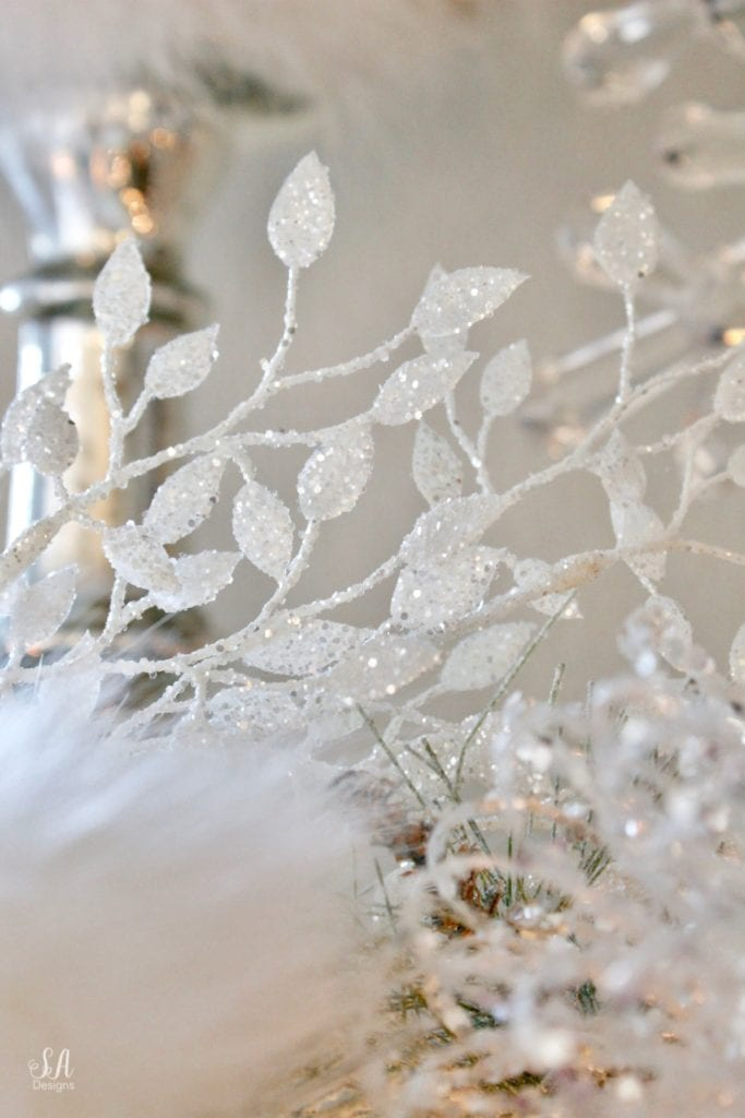 dreamy whimsical fantasy playful christmas mantel, faux fur stockings with snowflakes, christmas flocked garland with jewel rhinestone gold glitter pearl jewels garland, blush feather, faux fur pom poms, white glitter berry christmas stems, sparkly glitter christmas magnolia stems, dusty blue velvet ribbon, glitter snowflakes, joann fabric white swan figures, mercury glass candlesticks, cozy glam winter wonderland christmas, white fireplace marble tile, christmas glitter stems and picks