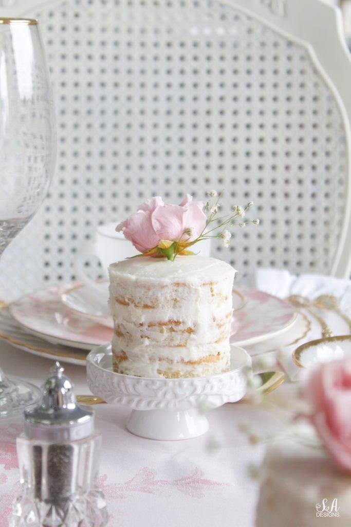 individual mini naked white cake on cupcake stand