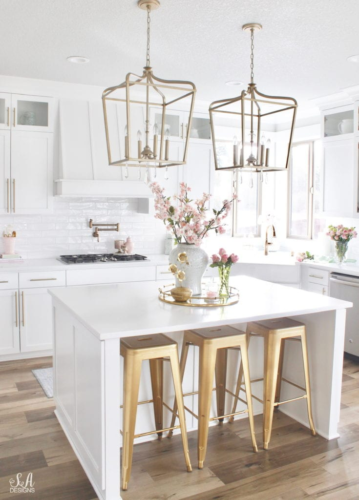 blush pink and green spring decor, spring kitchen decor, the best faux and fresh floral, white kitchen, classy white kitchen, classy interiors brass hardware, elegant white kitchen, elegant kitchen, blogger kitchen, gold brass hardware, gold brass barstools