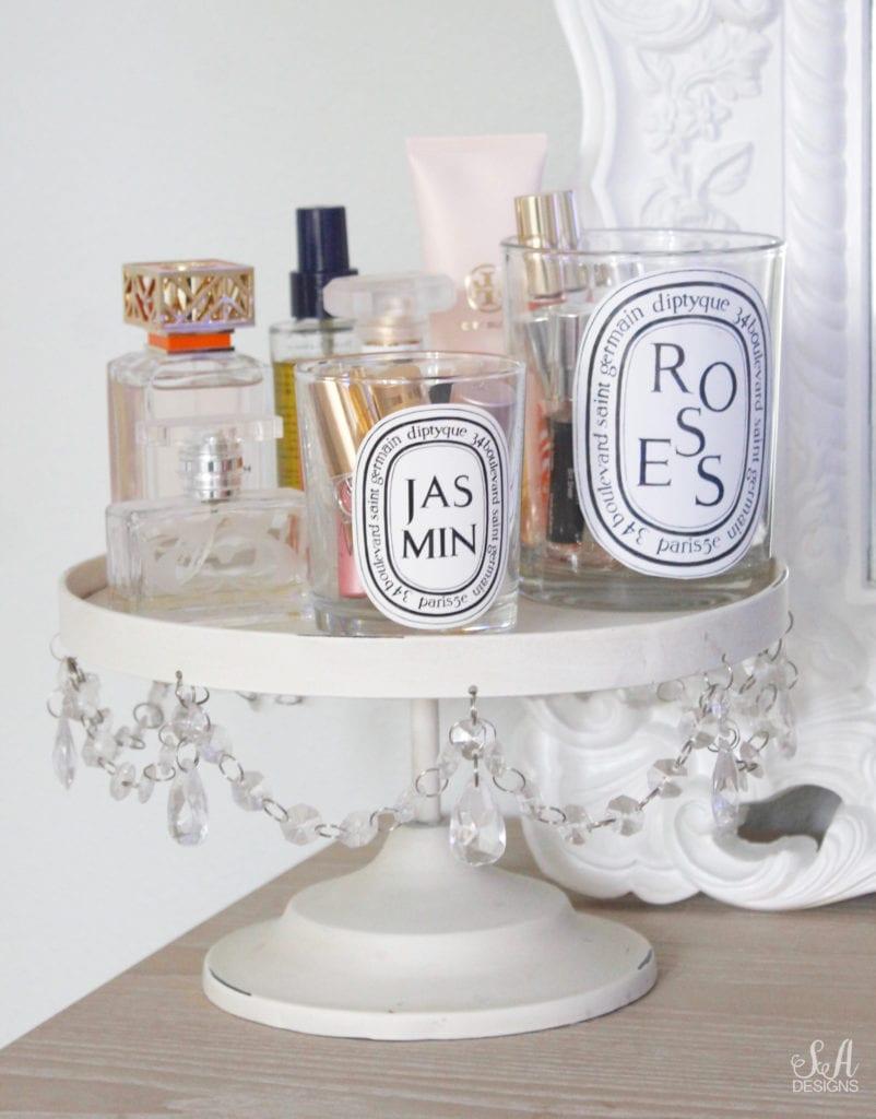 empty diptyque paris candle jar holding lipsticks vanity, empty diptyque roses jar holding perfumes