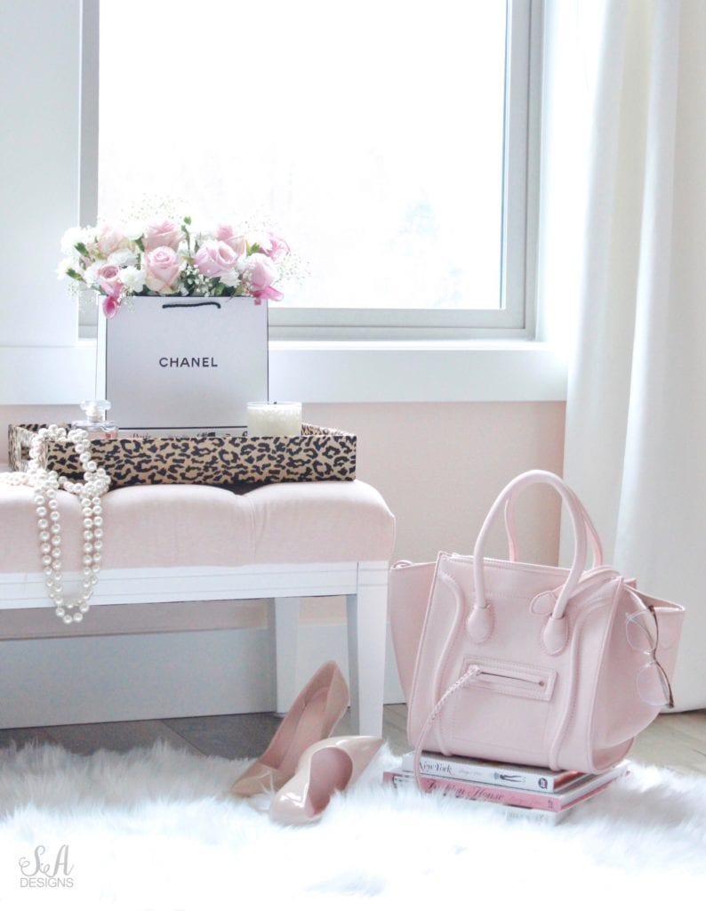 chanel shopping bag with real fresh flowers, celine pink handbag, nude patent heels pumps, faux fur rug, blush pink tufted bench, real vintage pearls, leopard print tray, repurposed designer shopping bag, chanel bag