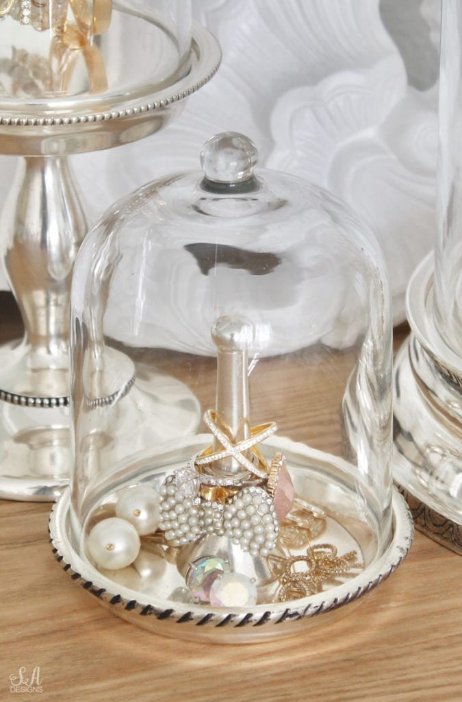 pottery barn jewelry storage organizers, organize and style your vanity and bathroom, jewelry storage, makeup storage ideas, perfume display ideas, elegant chic classy glamorous vanity, glass cloche jewelry storage antique silver, ring holder with cloche