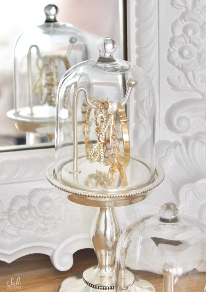 pottery barn jewelry storage organizers, organize and style your vanity and bathroom, jewelry storage, makeup storage ideas, perfume display ideas, elegant chic classy glamorous vanity, glass cloche jewelry storage antique silver, bracelet holder with cloche