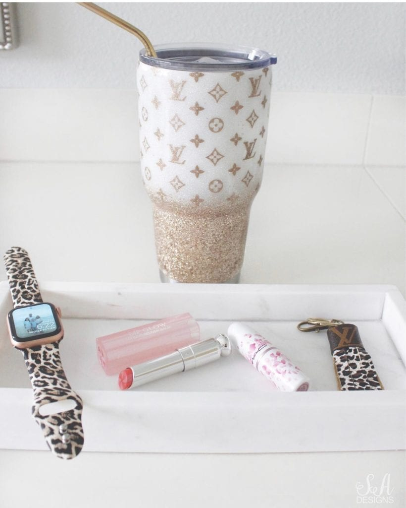 iwatch apple watch with amazon leopard print band, mac lipstick ysl lipstick, louis vuitton leather upcycled keychain