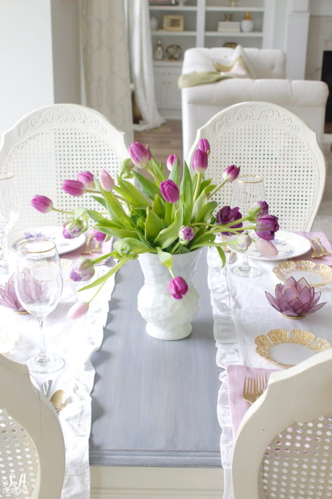 summer tablescape, spring tablescape, purple tablescape, purple tulips arrangement, purple lavender tulips, purple double peony tulips, double tulip peonies, antique french lavender transferware plates, paris france flea market find, gold flatware, purple orchid dinner napkins world market, gold rimmed crystal goblets, purple petal lotus capiz tea light holder world market, white ruffle linen table runners, crystorama clear crystal chandelier, anthropologie mauve lavender blouse top, white kitchen design, pacific northwest interior designer blogger fashion blogger summer adams designs, white milkglass vase