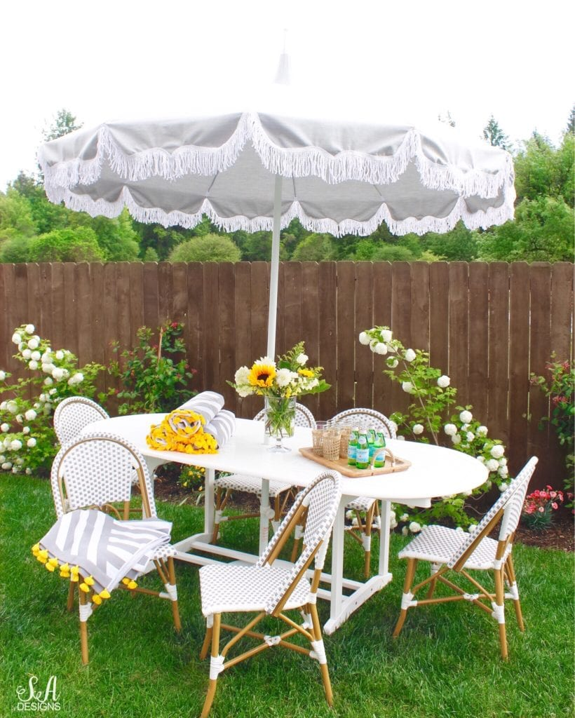 serena and lily outdoor umbrella grey with white fringe