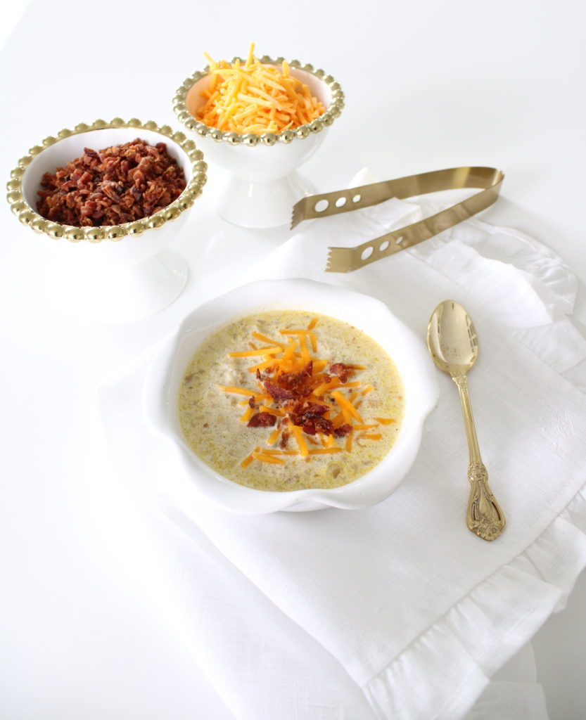 keto soup recipes, keto fall recipes, low-carb soup recipes, Atkins soup recipes, Keto cauliflower, Atkins cauliflower, low-carb cauliflower, cauliflower and cheese soup, creamy cauliflower soup, white and gold, white ruffle linen napkin, gold spoon, white and gold beaded bowls, loaded cauliflower soup, white and gold velvet pumpkins, elegant fall decor, white and brass kitchen