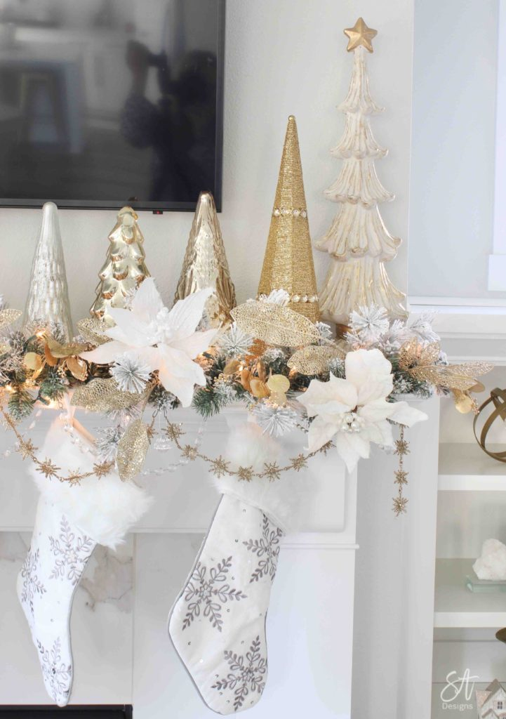 white and gold elegant glam Christmas decor, Christmas coffee table, ornaments in ZGallerie beaded pedestal bowl with ribbon, terrain Anthropologie Santos crowns, crowns on candlesticks, mercury glass candlesticks, Christmas coffee table