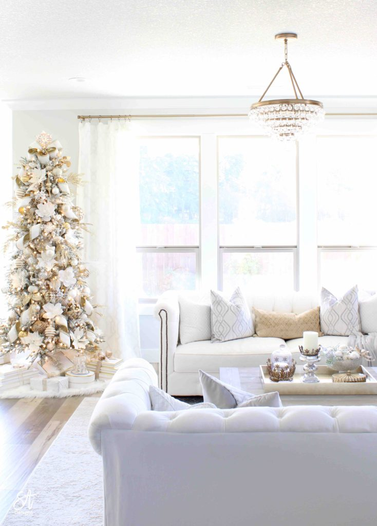 white and gold elegant glam Christmas decor, Christmas coffee table, ornaments in ZGallerie beaded pedestal bowl with ribbon, terrain Anthropologie Santos crowns, crowns on candlesticks, mercury glass candlesticks, Christmas coffee table, crystorama calypso chandelier