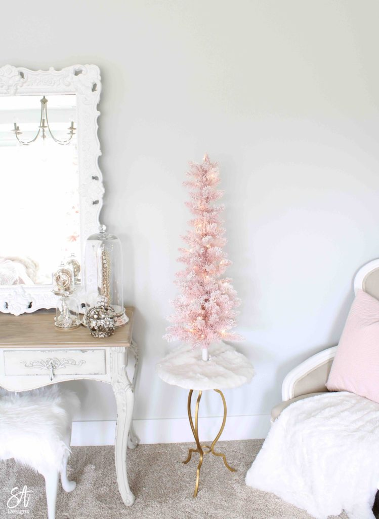 white Christmas tree, pink poinsettia Christmas ornaments, vintage pink glass ornaments, crown Christmas tree topper, romantic Christmas bedroom, blush pink mercury glass trees, glitter reindeer, blue pink velvet quilted bedding, blush pink fringe ottoman, pottery barn jewelry storage, Christmas bedroom decor ideas, master bedroom Christmas decorating ideas, Macy's holiday lane tabletop pink Christmas tree, pink flocked Christmas tree