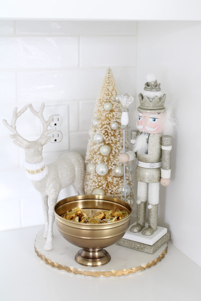 white and gold Christmas kitchen, glam Christmas kitchen, ribbon bows on kitchen pendants lighting, Christmas bows on kitchen lights, elegant Christmas kitchen, classy Christmas kitchen decorating, d. Stevens white and gold rhinestone Christmas ribbon, specialty white velvet gold rhinestone wired edge ribbon, gold barstools, Christmas floral arrangements, white and gold Christmas wreath, white kitchen design, white Christmas decor, white and gold Christmas kitchen decor, nutcracker