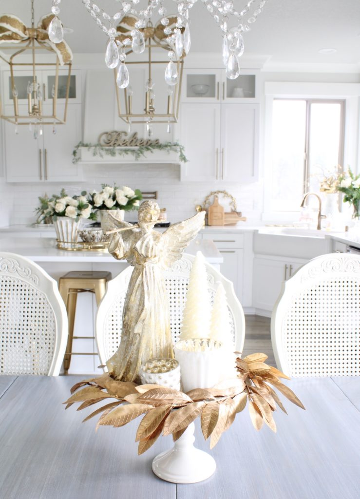 angel centerpiece for Christmas, gold wreath on white cake stand, white and gold Christmas kitchen decor