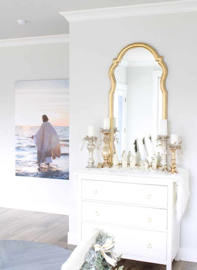 white and gold Christmas buffet, white and gold nativity creche, gold tall mirror, tall photograph canvas portrait christ reflections of christ