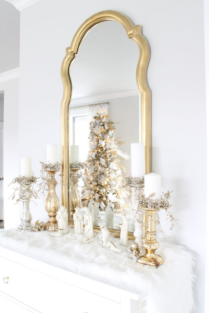 white and gold Christmas buffet, white and gold nativity creche, gold tall mirror,
