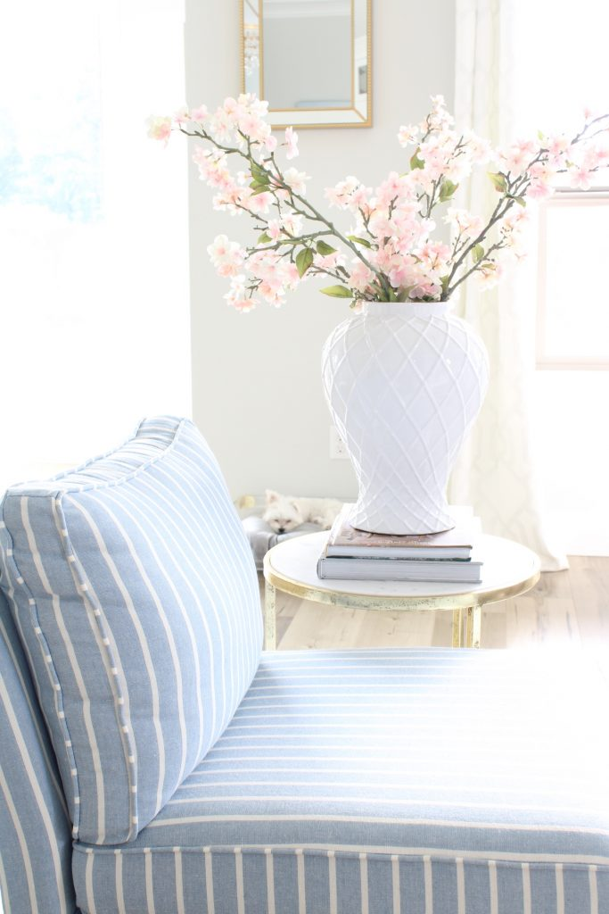 Caitlin Wilson pillows, crystorama chandelier, calypso chandelier, blue and white striped slipper chair, white tufted sofa, spring decorating tips, how to decorate your home for spring, blogger spring home tour, spring home goals, hgtv spring home design inspiration, gorgeous spring decorating, glam spring decor, elegant spring decor, pink and blue spring decorating tips ideas