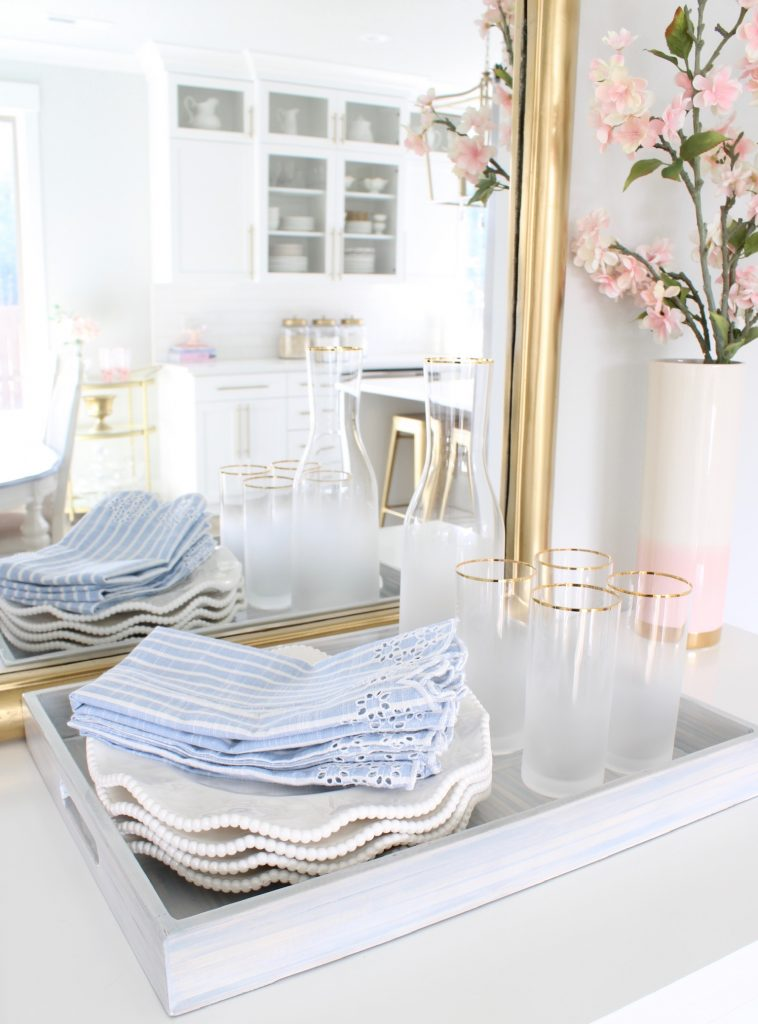 white and blue dining room spring decor and serve ware