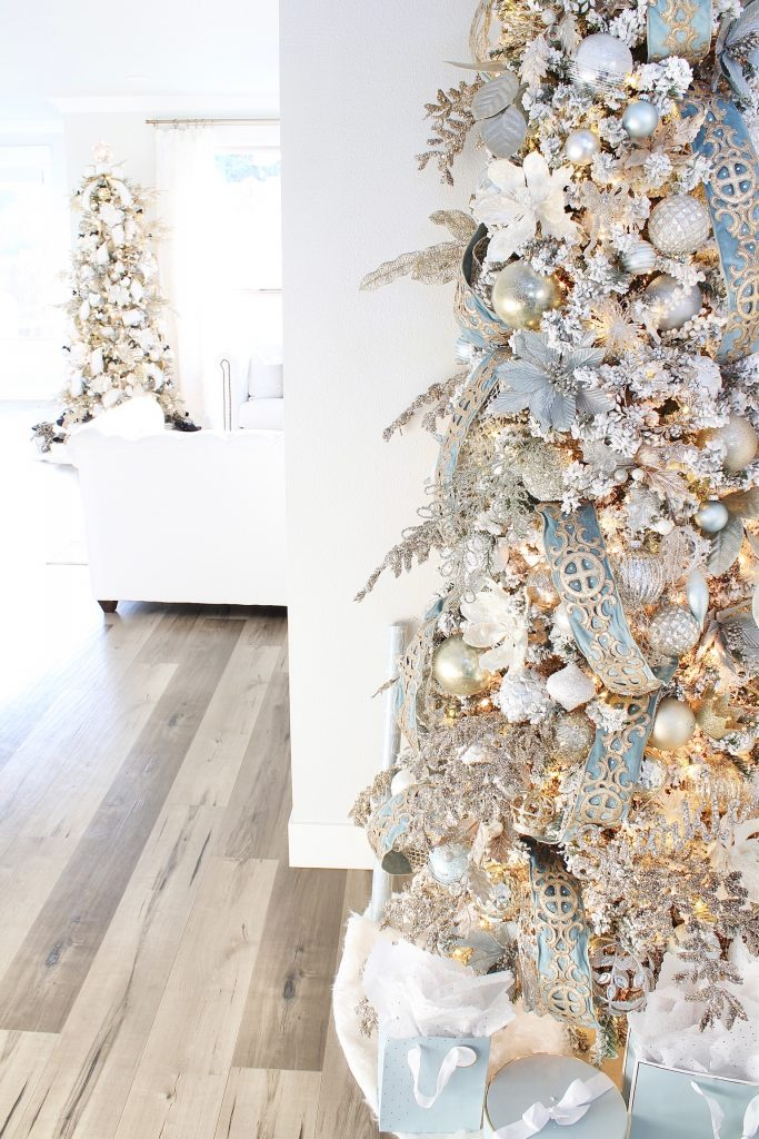 trinity scroll velvet ribbon spa blue wired edge christmas ribbon, flocked christmas tree, glamorous christmas tree decorating tips, christmas tree stems, how to decorate a christmas tree, how to create an elegant christmas tree