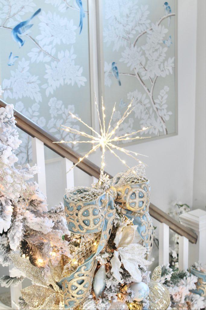 twinkling starburst LED star target, chinoiserie handprinted framed wall panels, christmas glam decor flocked tree,white flocked prelit christmas garland for banister staircase, trinity scroll velvet ribbon spa blue wired edge christmas ribbon, flocked christmas tree, glamorous christmas tree decorating tips, how to create a glam christmas tree, christmas decorating Tips, how to decorate a Christmas tree, elegant chic christmas tree entry, dramatic christmas entry, christmas tree stylist, blogger christmas tree, pottery barn mercury glass christmas trees